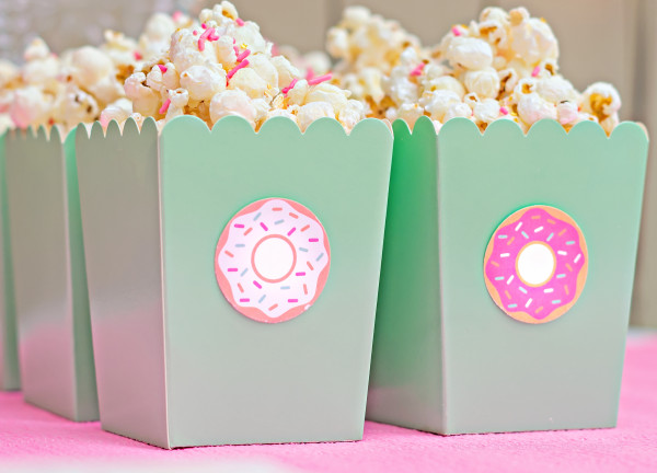 As much as we would like to only eat donuts, sometimes it's nice to have a little variety. We filled these popcorn boxes with marshmallow cream coated popcorn and topped it with yummy sprinkles.