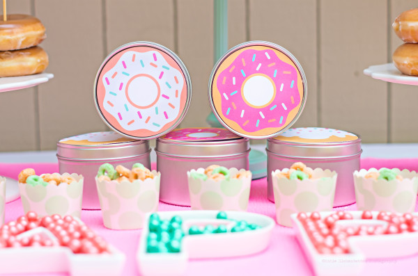 These tins, filled with donut shaped sugar cookies, are perfect for sending your guests home with a little something sweet.