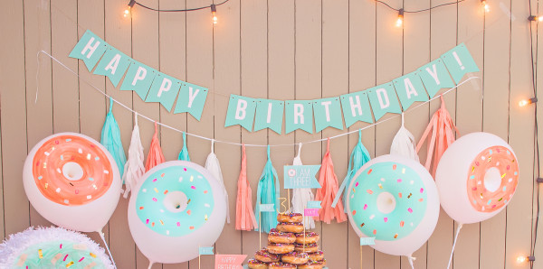 Add a fun back drop to your table using our birthday banner and tissue tassels.