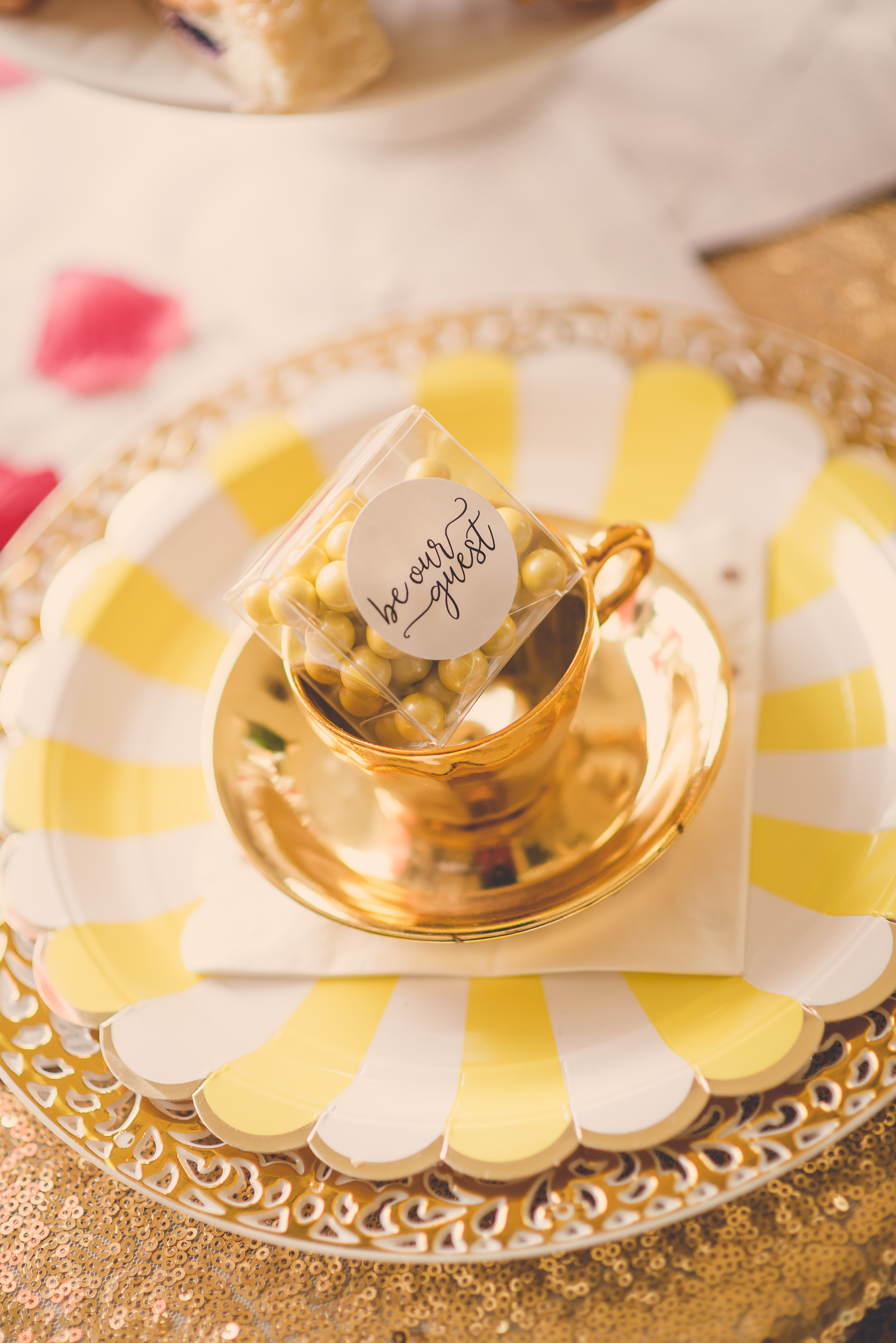 our custom favors look so cute in the little gold tea cups and check out our yellow scalloped plates and rose gold napkins